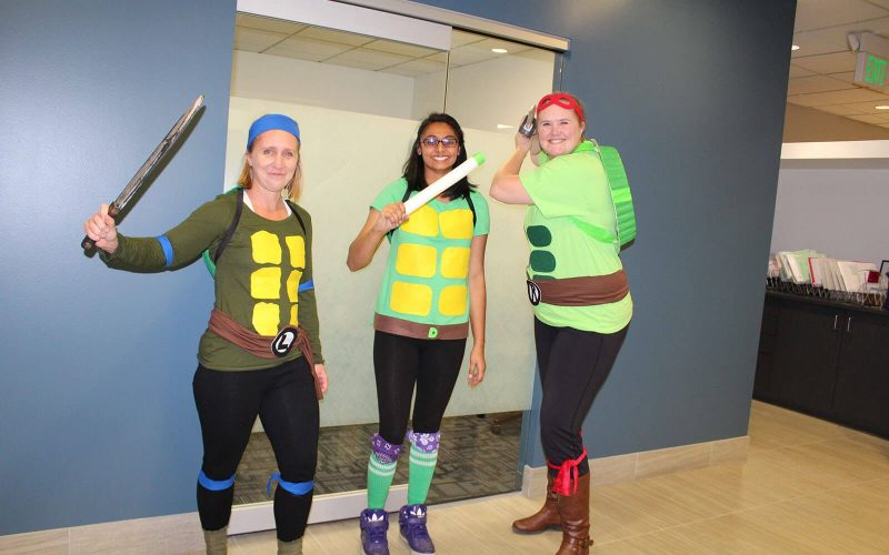 Shannon & Associates employees dressed as Halloween Ninja Turtles